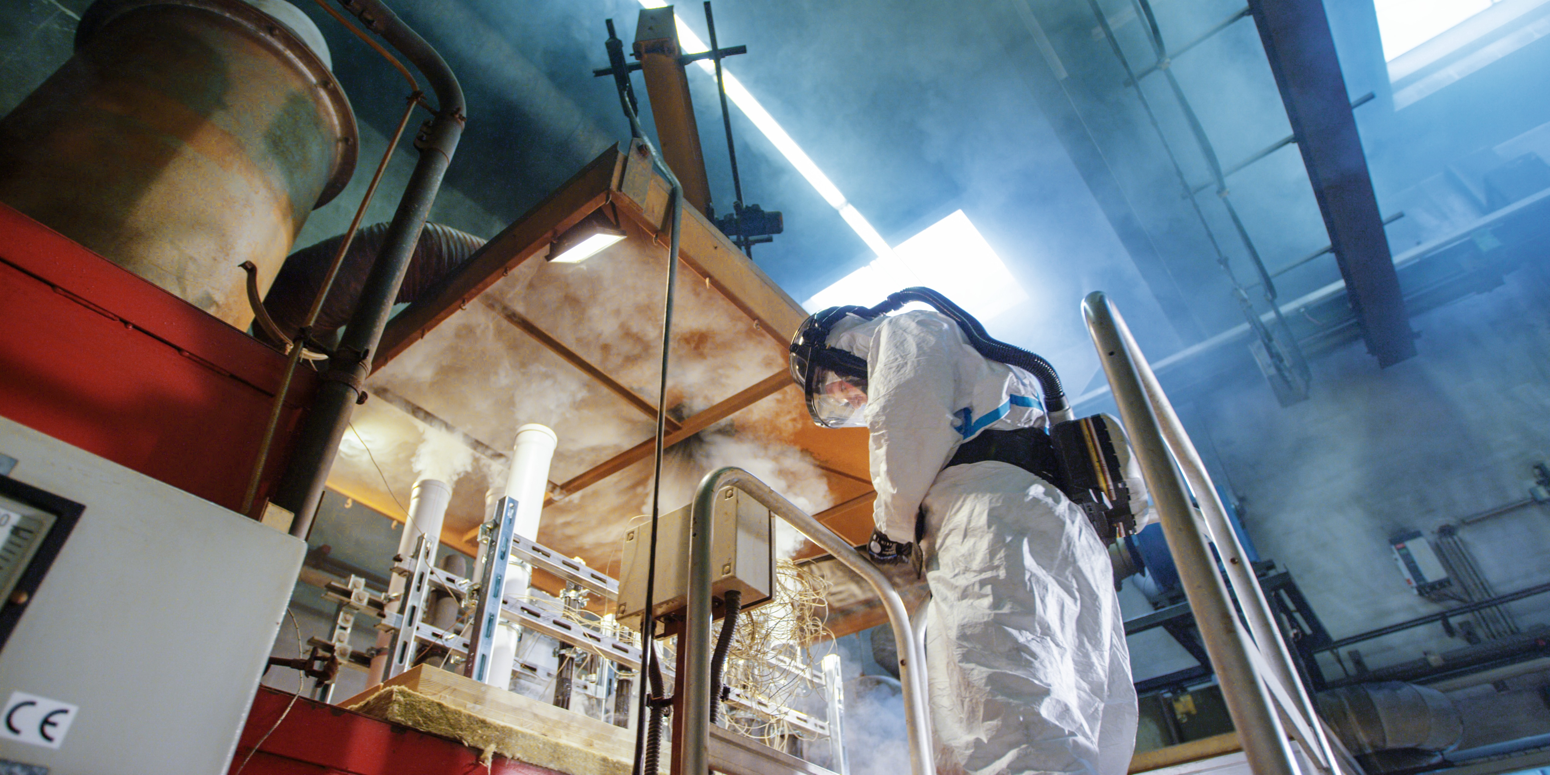 Image of a firestop engineer carrying out a firestop text in laboratory conditions